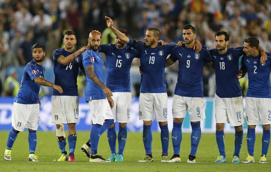 Italy's Siimone Zaza is comforted by his teammates after failing to score in the penalty shoot out of the Euro 2016 quarterfinal soccer match between Germany and Italy, at the Nouveau Stade in Bordeaux, France, Saturday, July 2, 2016. (ANSA/AP Photo/Michael Probst)